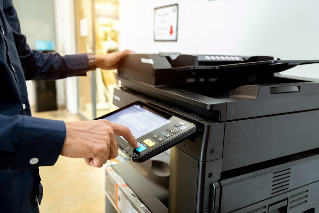 man at printer printing