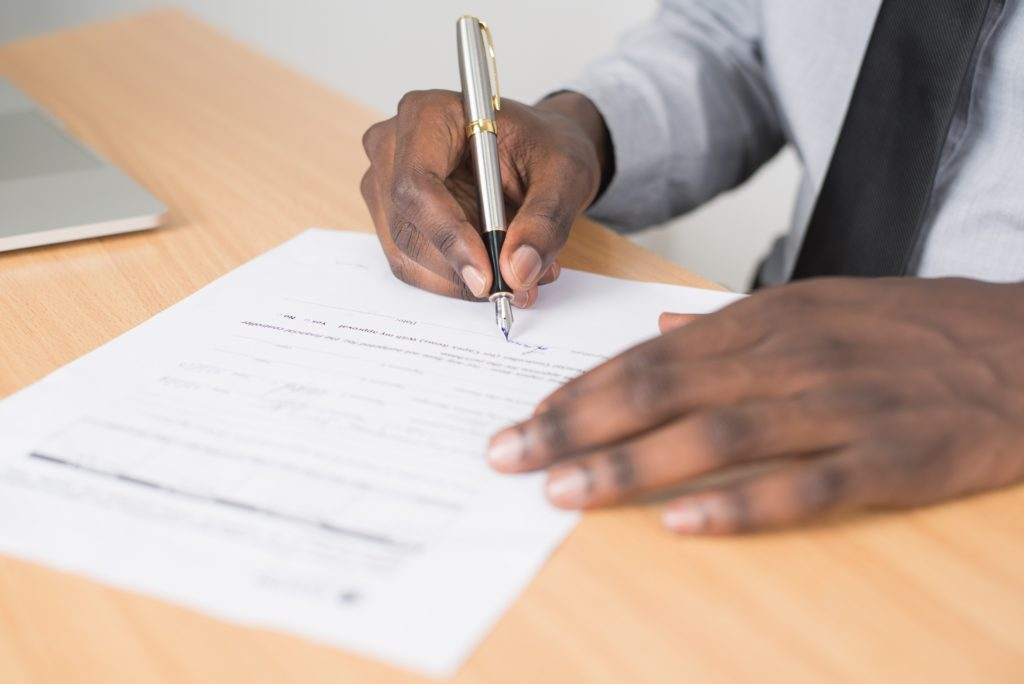person signing rental contract