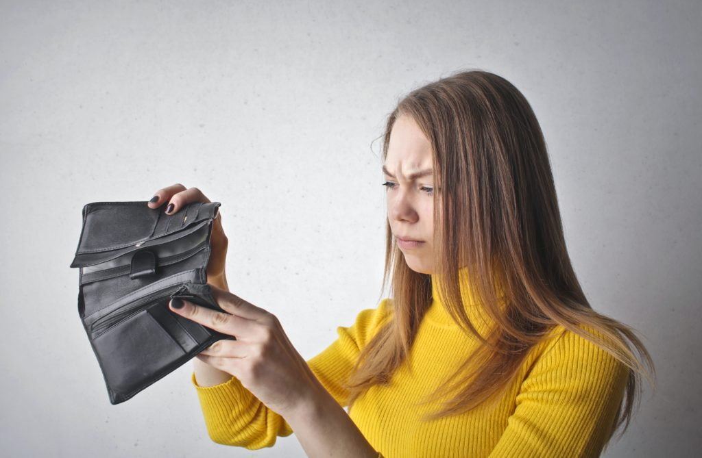 person holding empty wallet