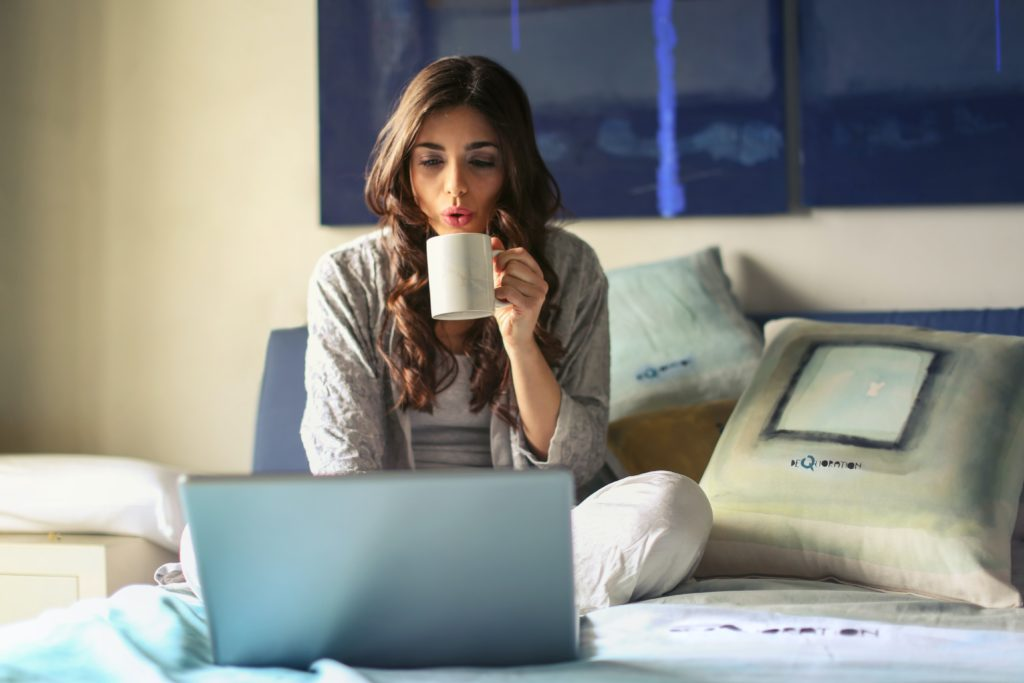 work from home women on bed
